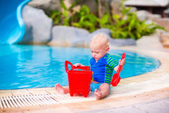 Baby boy playing at a pool Stock Photography