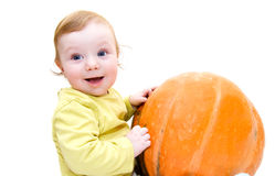 Baby boy playing with pumpkin Royalty Free Stock Image