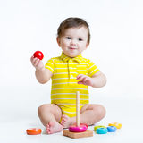 Baby boy playing with pyramid toy Stock Image