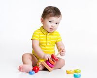 Baby boy playing with pyramid toy Stock Photography