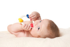 Baby boy playing with rattle Stock Image