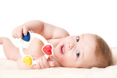 Baby boy playing with a rattle Stock Image