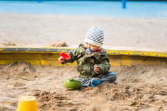 Boy playing in the sand box royalty free stock photo