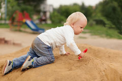 Baby Boy Playing in the Sandbox Royalty Free Stock Images