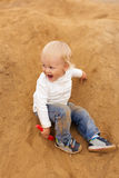 Baby Boy Playing in the Sandbox Royalty Free Stock Photo