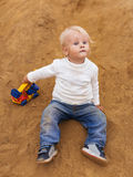 Baby Boy Playing in the Sandbox Stock Photography