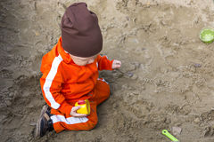 Baby boy is playing in sandbox Royalty Free Stock Photo