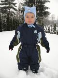 Baby boy playing in snow Stock Photography