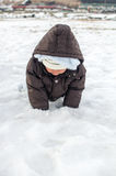 Baby boy playing snow Royalty Free Stock Images