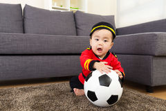 Baby boy playing with soccer ball Royalty Free Stock Photos