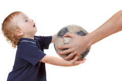 Baby boy playing with a soccer ball. Isolated on white Stock Images