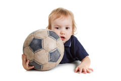 Baby boy playing with a soccer ball. Isolated on white Royalty Free Stock Image