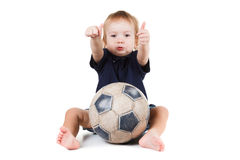 Baby boy playing with a soccer ball. Isolated on white Stock Photo