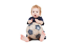 Baby boy playing with a soccer ball. Isolated on white Royalty Free Stock Photography