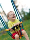 Baby boy playing on swing Royalty Free Stock Photo