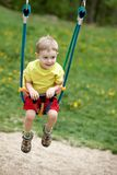 Baby boy playing on swing Stock Photography