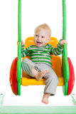 Baby boy playing on the swings Stock Photography