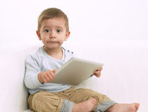 Baby boy playing with tablet Stock Images