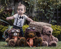 Baby boy playing with teddy bears at the garden Royalty Free Stock Photography