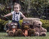 Baby boy playing with teddy bears at the garden Royalty Free Stock Images