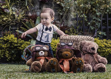 Baby boy playing with teddy bears at the garden Stock Photo