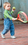 Baby boy playing tennis. Little baby boy playing tennis in the backyard Stock Images