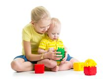 Baby boy playing together with sister Royalty Free Stock Images