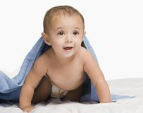 Baby boy playing with a towel Royalty Free Stock Images