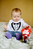 Baby boy playing toy Stock Photos