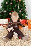 Baby boy playing with a toy at christmas Royalty Free Stock Image