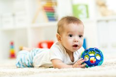 Baby boy playing with toy indoor Royalty Free Stock Image