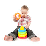 Baby boy playing with toy pyramid Royalty Free Stock Images