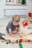 Baby boy playing of the toy railroad Royalty Free Stock Images
