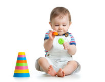 Baby boy playing with toy Stock Photos