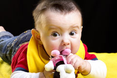 Baby boy playing with toy royalty free stock photography