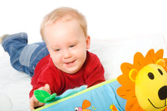 Baby boy playing with toys Royalty Free Stock Photos