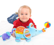 Baby boy playing with toys Stock Images