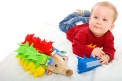 Baby boy playing with toys royalty free stock photography