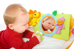 Baby boy playing with toys Royalty Free Stock Images