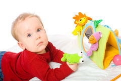Baby boy playing with toys Stock Photo