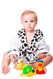 Baby boy playing with  toys after bathing Stock Photo
