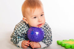 Baby boy playing with  toys Stock Photos