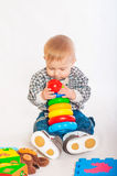 Baby boy playing with  toys Royalty Free Stock Image