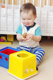Baby boy playing toys at home Royalty Free Stock Photo
