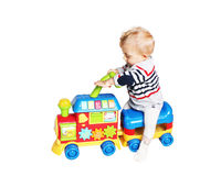 Baby boy playing with train toy. Isolated on white background Royalty Free Stock Photography