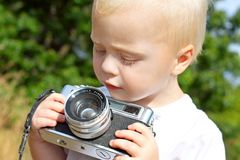 Baby Boy Playing with Vintage Camera Stock Images