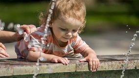Baby Boy Playing With Water In Fountain stock footage