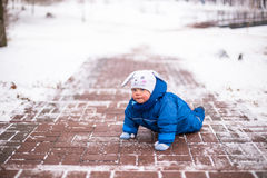Baby boy playing in winter park. Happy family enjoy snow and winter on holidays Stock Photography
