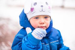 Baby boy playing in winter park. Happy family enjoy snow and winter on holidays Stock Image