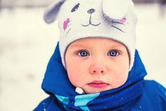 Baby boy playing in winter park. Happy family enjoy snow and winter on holidays Royalty Free Stock Photos